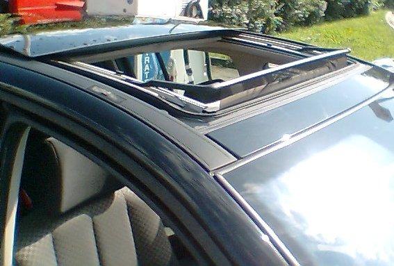 Presentation de ma megane auto titre for Garage reparation toit ouvrant