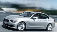 Essai BMW 330e : L'homme d'affaires gris dans une veste verte